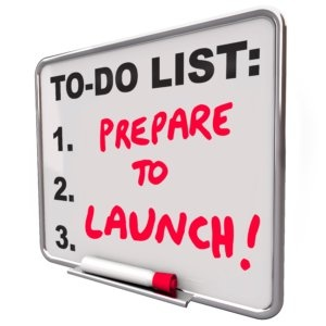 Prepare to Launch words on a to-do list to remind you of the deadline to get ready to start or unveil your new product, business, company or service