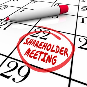 Shareholder Meeting day and date circled on a calendar or schedule as a reminder for investors and financial planners to see a presentation on a company or business