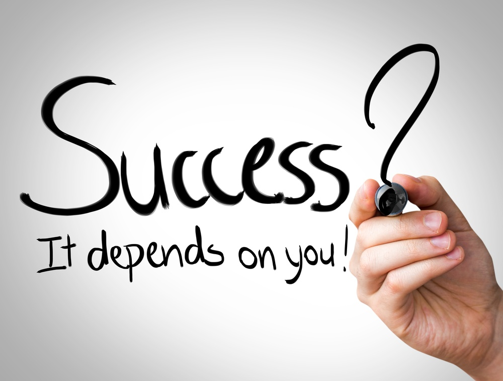 """""""Success, it depends on you"""" Hand writing with black marker on transparent wipe board.jpeg"""