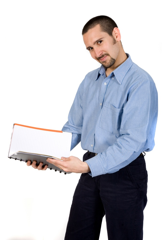 business man reading a book over white.jpeg